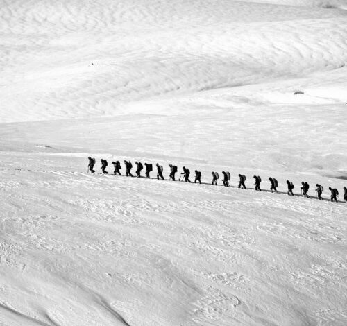 Canva - Group Of People Trecking In The Snow