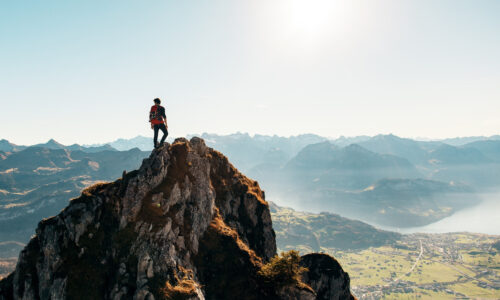 Canva - Man Standing on Top of a Rocky Mountain